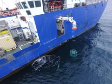 water sampling instrument lowered from ship