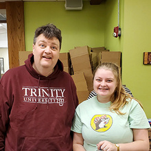 Curtis and his daughter at the food bank