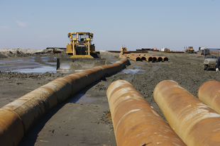 A large pipeline moves sediment to restore Chenier Ronquille barrier island in Louisiana