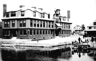 Photo of the original 3 story building that housed the Center.