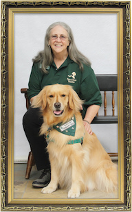 Margaret McCahill, B.S. '76, zoology, with her therapy dog Portia. Courtesy of Margaret McCahill. Frame photo: Michal Zacharzewski, freeimages.com.
