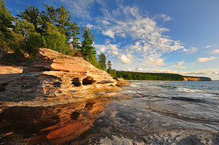 View of water and rocks from beach at Pictured Rocks National Lakeshore