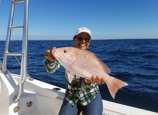 Woman holding red snapper