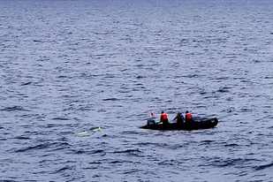 Recovering the glider from a small boat.
