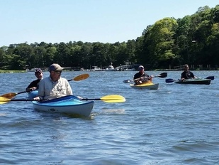 people kayaking off Cape Cod