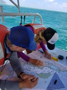 The team learned how to navigate with nautical maps