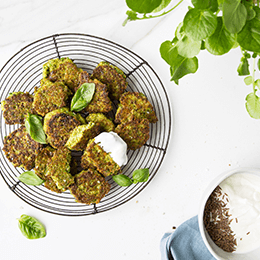 Cheesy Baby Pea and Basil Fritters with Carraway Yoghurt