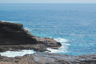 Anglers fish from rocks on the east side of Oahu.