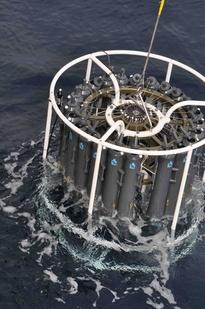 Sampling bottles lowered into ocean