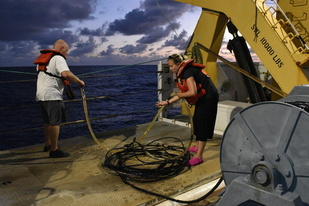 Acoustician prepare to deploy the hydrophone array to eavesdrop on whales and dolphins.
