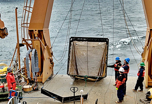 The Methot net being recovered over the stern of the USCGC Healy after finishing a tow. Photo courtesy of A. Lyons.
