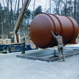A vacuum chamber being lowered into Professor Joseph Weber's gravitational research building on the University of Maryland's golf course in 1970. Courtesy of Darrell Gretz. (Click image to download hi-res version.)