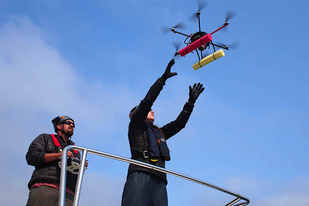 NOAA scientists deploying a hexacopter for research
