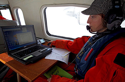 Marine mammal scientist Amelia Brower surveying gray whales from the air.