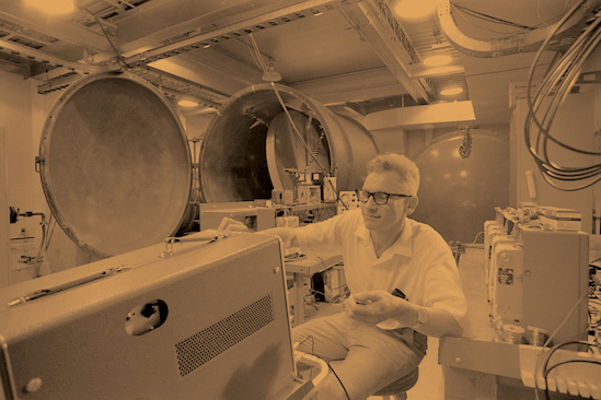 Joseph Weber in his lab in 1971. Behind him, at left, is the vacuum chamber that was lowered into the lab through the roof. Photo: University of Maryland Archives. (Click image to download hi-res version.)