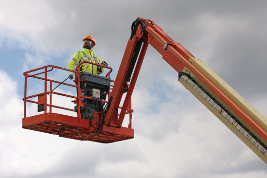 Industrial worker on bucket lift