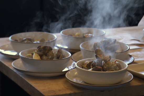 Bowls of steaming hot clams