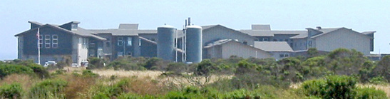 The Santa Cruz Laboratory, seen in the distance from across a meadow