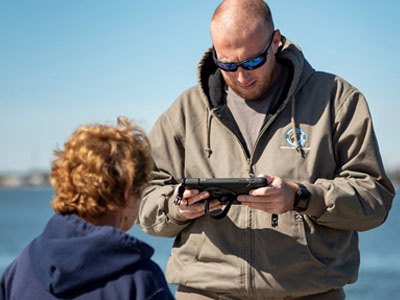 A sampler collects information from a recreational angler.