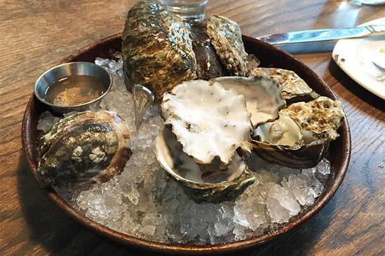 Oysters on ice at a restaurant table