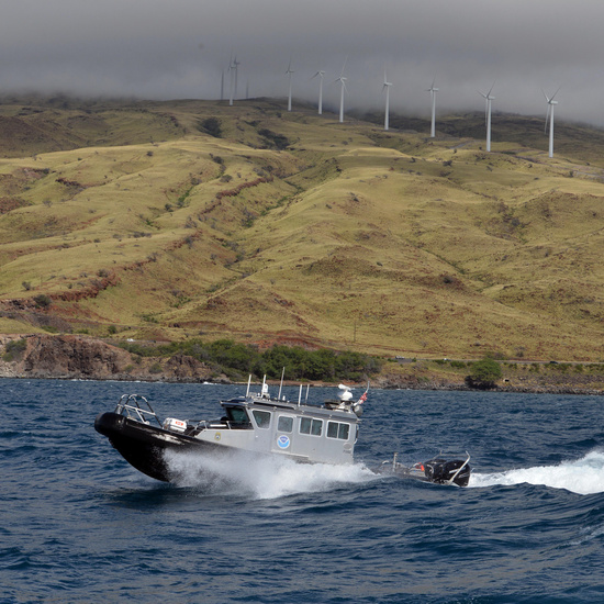 A NOAA law enforcemet boat patrols offshore Maui