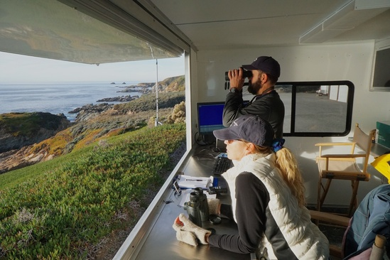 Observers on watch for gray whales at Granite Canyon study site. Photo: NOAA Fisheries