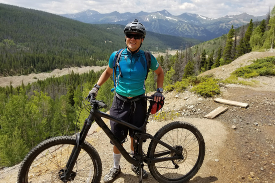 Giovanni Gianesin poses with mountain bike, surrounded by Colorado mountains.