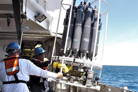 crew retrieving CTD carousel frame at sea