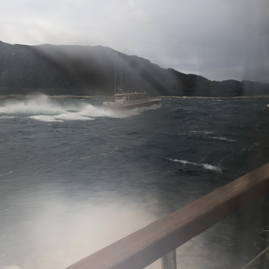 View outside ferry window of rough seas while traveling to Qaqortoq, Greenland.