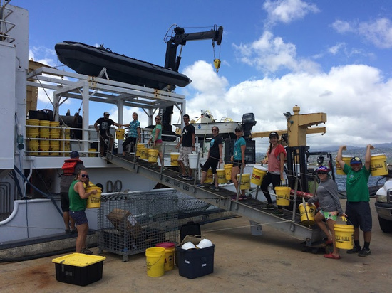Field staff pack the NOAA Ship Sette for the trip to the Northwest Hawaiian Islands.