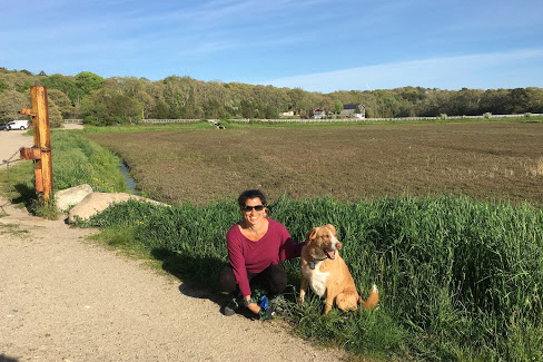 iersten and her dog Oliver next to a cranberry farm.