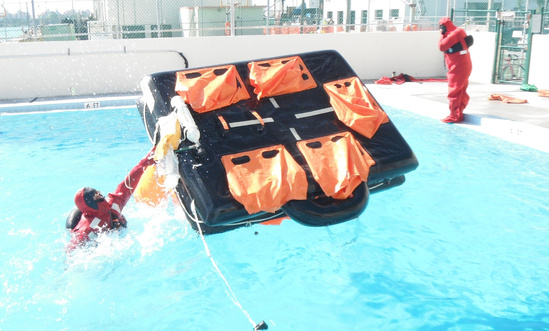 Observers training on a life raft