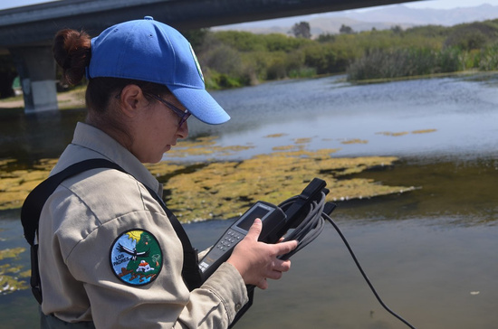 California Corps Member using GPS in the field