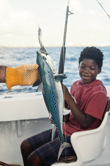 iStock-959363078-boy-fish-on-line.jpg