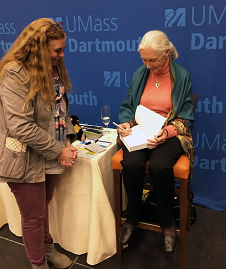 Jane Goodall signing a book for Amy