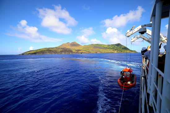 Small boat deploys from the NOAA Ship Hi'ialakai for coral reef surveys at Guguan Island