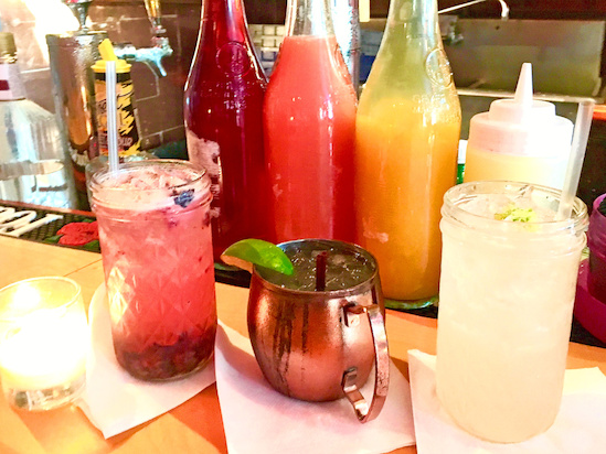 Assorted cocktails at Bar DKDC, where well drinks are $1 off during happy hour.