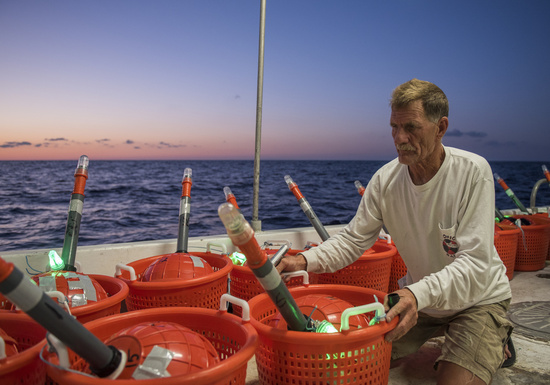 A Florida fisherman working with buoy gear on the F/V Outlaw.